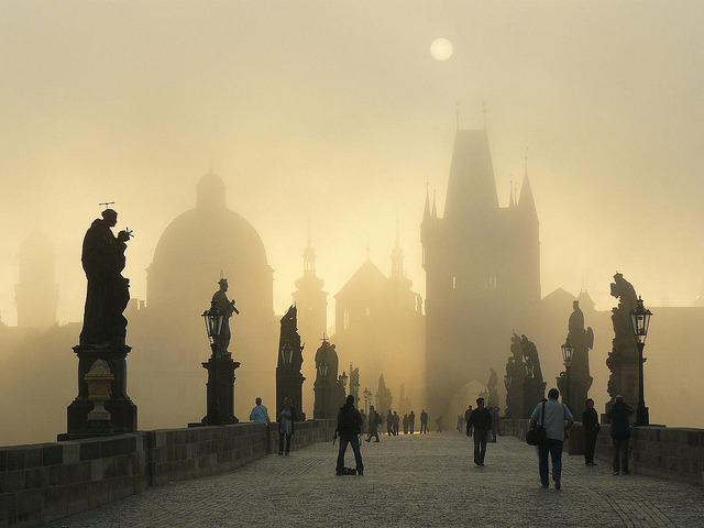 by n_ila on Flickr.Early sunrise at Charles Bridge, Prague, Czech Republic.