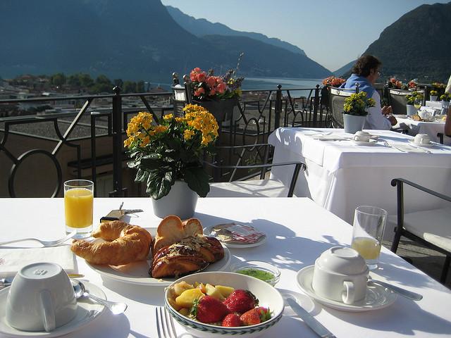 Having breakfast on the shores of Lago Maggiore, Ticino, Switzerland