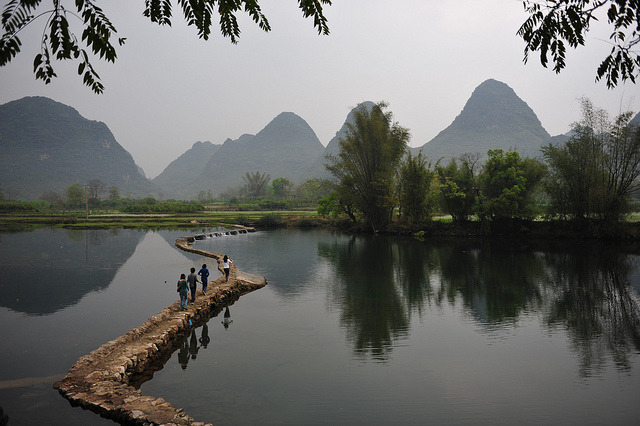 Walking on the river, Yangshuo, China