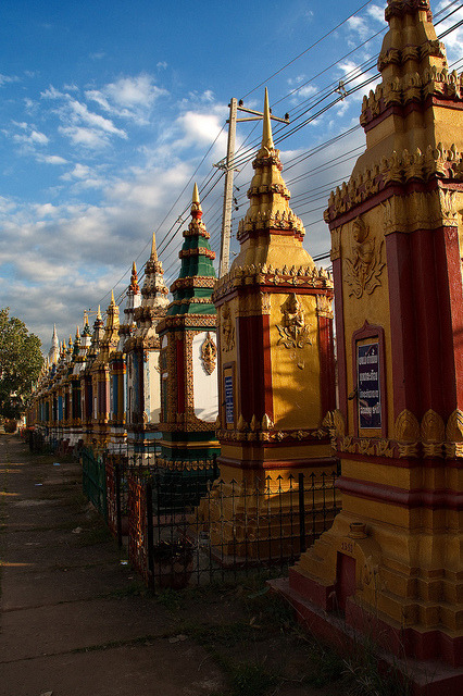 Stupas in a Line at Vat Tham Fai temple in Pakse, Laos