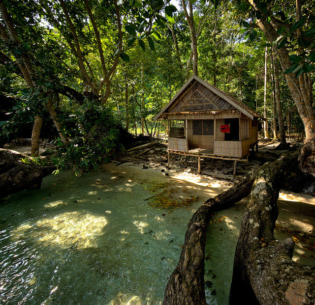 Wooden cabin at the end of Milne Bay, Papua New Guinea