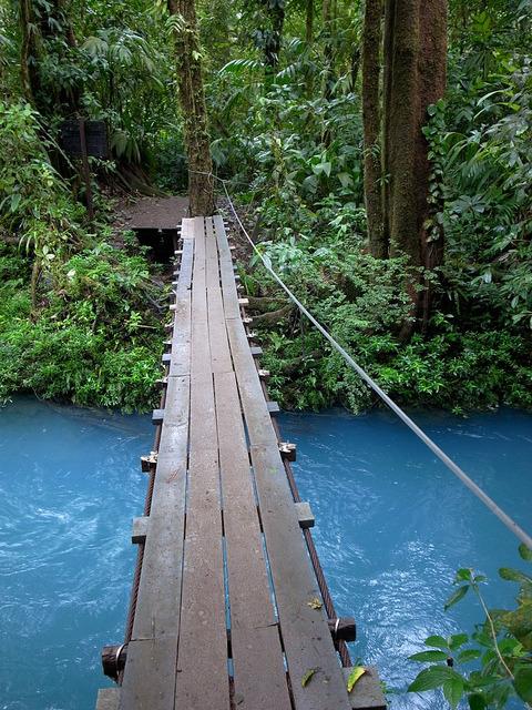 Bridge crossing Rio Celeste in Tenorio Volcano National Park, Costa Rica