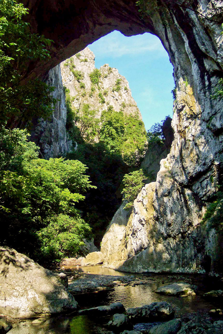 Natural arch in Vratna River Gorge in eastern Serbia.